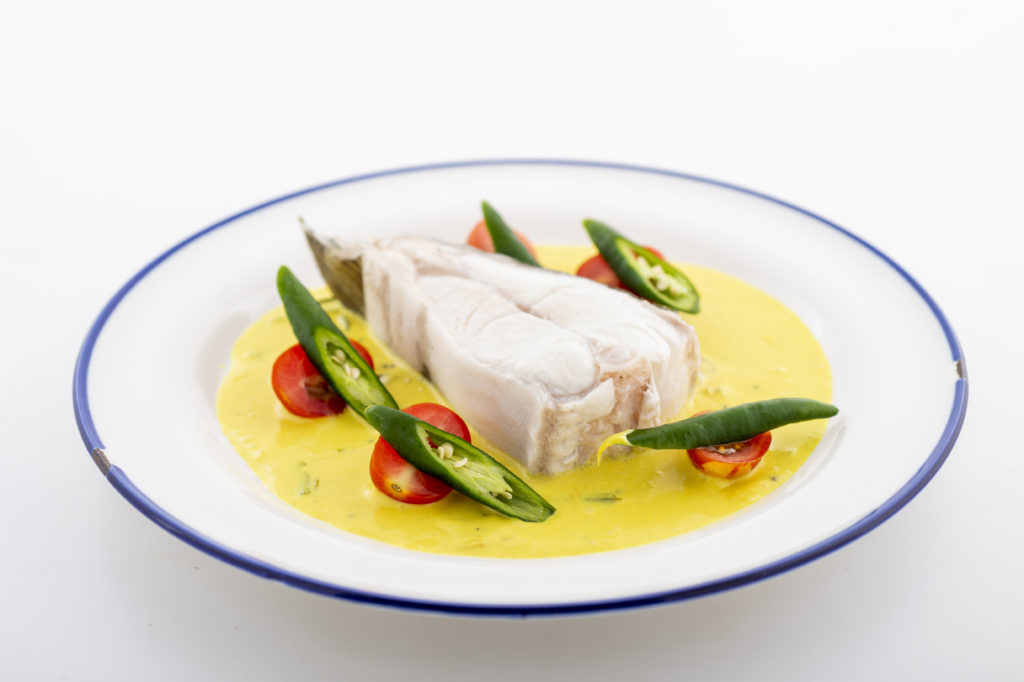 Nordic Halibut molee on a dinner plate