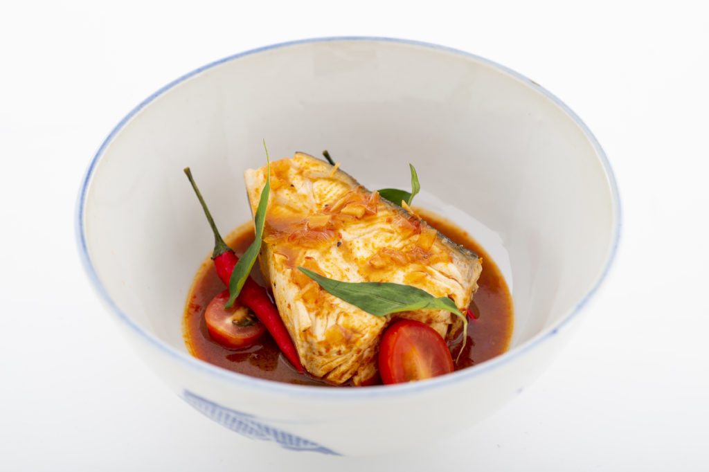 Nordic Halibut in spicy tamarind broth in a white bowl with blue decorations