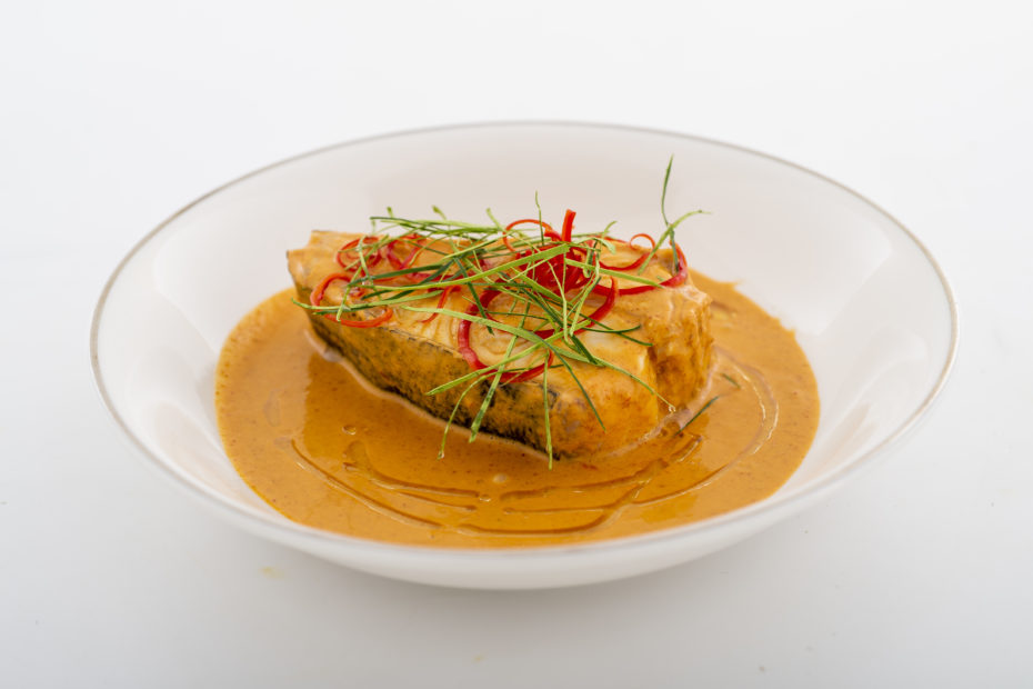 Nordic Halibut in Thai red curry in a bowl