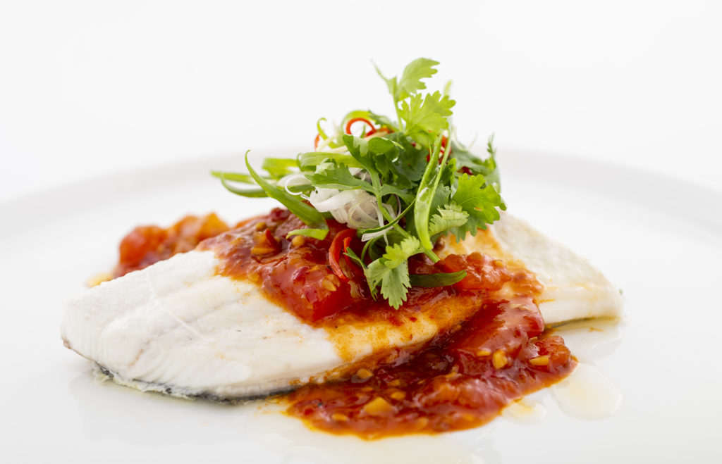 Steamed Nordic Halibut with chilli bean sauce on a dinner plate