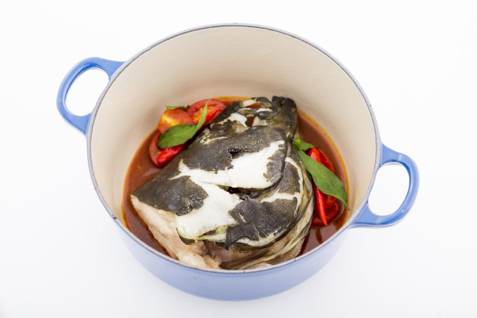 Nordic Halibut head in spicy tamarind broth in a pot
