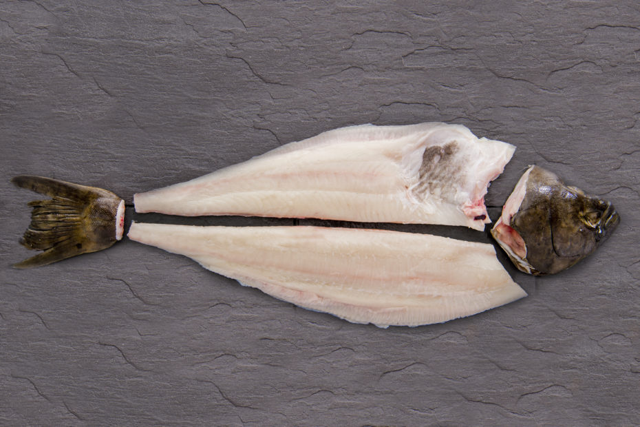 Filleted halibut on a table