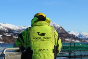 A Nordic Halibut employee by the sea cages